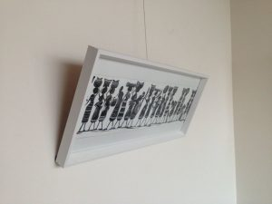 picture leaning forward on picture hanging system