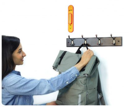 The StudBuddy Plus installing a coat hook